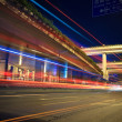 Light trails with highway viaduct — Stock Photo