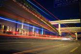 Light trails with highway viaduct — Stockfoto