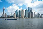 Shanghai skyline with cargo ship — Stockfoto