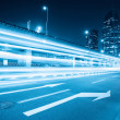Stock Photo: Light trails on the city road