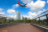Airliner and footbridge — Stock Photo