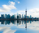 Shanghai skyline with reflection at daytime — Stock Photo
