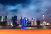 Shanghai skyline with pier at night — Stock Photo
