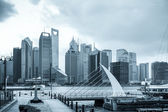 Shanghai skyline with pier — Stock Photo