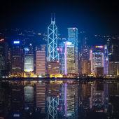 Hong Kong at night with reflections — Stock Photo