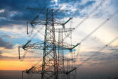 High voltage transmission pylon at dusk — Stock Photo