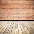 Stock Photo: Brick wall and wooden floor