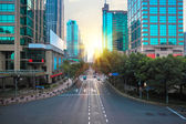 Modern city street scene in morning — Stock Photo