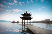 Hangzhou pavilion with sunset glow — Stock Photo