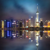Shanghai pudong skyline with reflection at night — Stock Photo