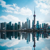 Cityscape of modern city with reflection in shanghai — Stock Photo