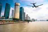 Modern city with aircraft — Stock Photo