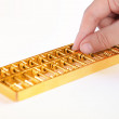 Golden abacus closeup — Stock Photo
