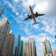 modern building with airplane under the blue sky — Stock Photo