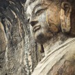 Locana buddha in longmen grottoes — Stock Photo