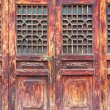 Traditional wooden door with lattice window — Stock Photo