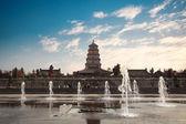 Big wild goose pagoda with fountain — Stock Photo