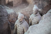Closeup of two terra cotta warriors in the pit — Stock Photo
