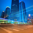 Urban roads car light trails of modern buildings — Stock Photo