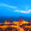 Container terminal at nightfall — Stock Photo