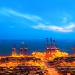 Stock Photo: Container terminal at nightfall