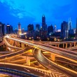 Traffic through modern city — Stock Photo