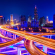 Stock Photo: Beautiful interchange overpass and city skyline