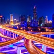 Beautiful interchange overpass and city skyline — Stock Photo