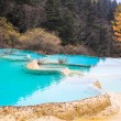 Stock Photo: Blue travertine ponds in huanglong