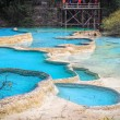 Blue travertine ponds in huanglong — Stock Photo #34678961