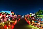 Chinese ancient town with grand canal at night — Stock Photo