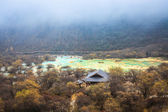 Travertine ponds in huanglong — Stock Photo