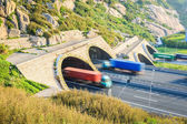 Trucks motion blur in tunnel exit — Stock Photo