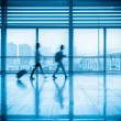 Commuters motion blurred in modern corridor — Stock Photo