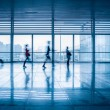 Stock Photo: Commuters motion blurred in modern corridor
