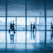 Passengers motion blur in modern corridor — Stock Photo