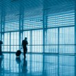 Passengers motion blur in modern corridor — Stock Photo #36568243