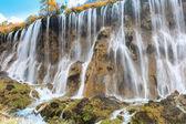 Beautiful waterfall in autumn — Stock Photo