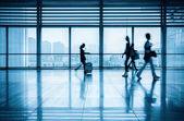 Passengers motion blur in modern corridor — Stock fotografie