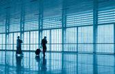 Passengers motion blur in modern corridor — Stock Photo