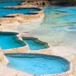 Blue travertine ponds — Stock Photo