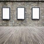 Three blank advertising light box on the wall — Stock Photo #36571341