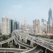 Modern city skyline with interchange overpass — Stock Photo