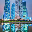 Stock Photo: Modern architecture and reflection at night