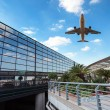 Modern airport terminal and aircraft — Stock Photo