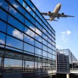 Airplane and airport terminal building — Stock Photo