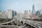 Modern city skyline with interchange overpass — Stock Photo