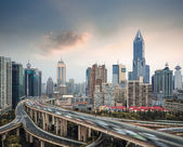 City skyline with elevated road — Stock Photo