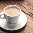 Espresso on old wooden table — Stockfoto