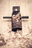 Wood planer and shavings closeup — Stock Photo